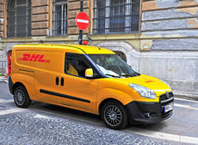 Yellow DHL van parked in the street of Budapest city Royalty Free Stock Photo