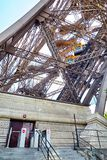 Yellow diagonal elevator inside the metal support of the Eiffel royalty free stock photos