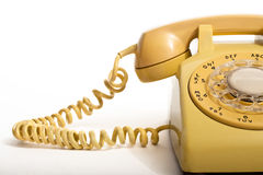 Yellow dial phone. Yellow rotary phone from the 1970s stock photography