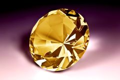Yellow diamond close-up. With violet background Royalty Free Stock Photography
