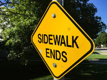 Yellow Diamond Shaped SIDEWALK ENDS sign. Bright Yellow Diamond Shaped SIDEWALK ENDS sign Stock Images