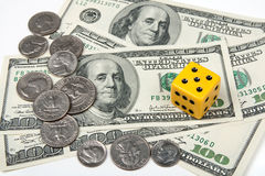 Yellow dice and money Royalty Free Stock Photos
