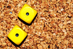 Yellow dices one one Stock Photos