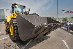 Yellow diesel front end loader on display Stock Image