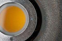 Yellow diffusing filter part of illuminator. Close-up - yellow diffusing filter part of studio illuminator with four screws on the iron part. Studio equipment stock photos
