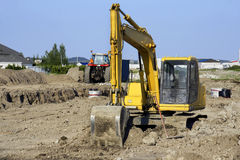 Yellow digger at big job site Royalty Free Stock Photos
