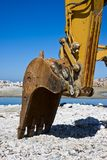 Yellow diggers. On the seashore building a breakwater Royalty Free Stock Image