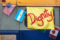 Yellow dignity banner on old bus Stock Photography