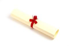 Yellow diploma scroll stock photography