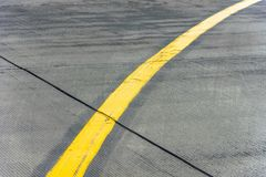 Yellow direction strip fork close up on an airfield runway. Royalty Free Stock Photos