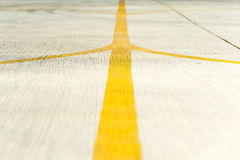 Yellow direction strips closeup on an airfield runway. Stock Image