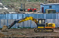 Yellow dirty excavator. On the construction yard Royalty Free Stock Photos