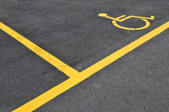 Yellow disabled people parking sign Royalty Free Stock Photos