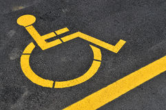 Yellow disabled people parking sign Stock Images