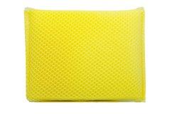 Yellow dishwashing sponge of isolate background Stock Images