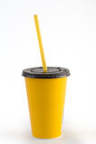 Yellow disposable cup with a drinking straw. Isolated on white b Stock Image