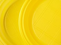 Yellow disposable dishes Royalty Free Stock Photo