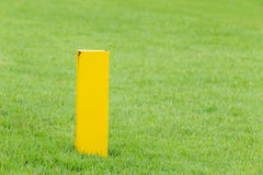 The yellow distance marker pole to inform range of golfing in gr Stock Photography