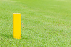 The yellow distance marker pole to inform range of golfing in gr Royalty Free Stock Images