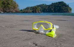 Yellow Dive Mask on Beach stock photos