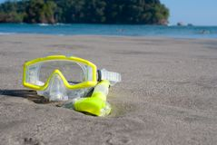 Yellow Dive Mask on Beach royalty free stock photos