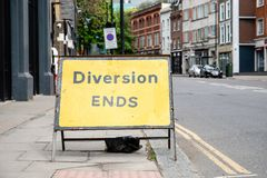 Yellow Diversion Ends road sign in a UK city street.  royalty free stock images