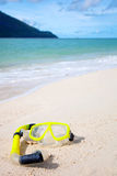 Yellow diving mask on the beach Stock Image