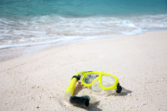 Yellow diving mask on the beach Stock Photo
