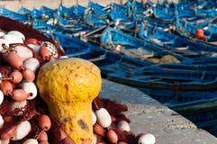 Yellow dock. Blue fishing boats in essaouira marina Royalty Free Stock Images