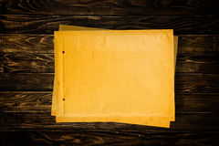 Yellow document envelopes on wooden tabletop Stock Image