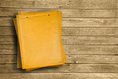 Yellow document envelopes on wooden tabletop Royalty Free Stock Photo