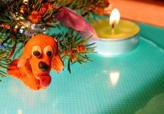 Yellow dog is plasticine stock image