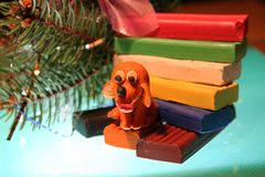 Yellow dog is plasticine royalty free stock photos
