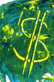 Dollar sign paint blotchy on paper artfull. Yellow Dollar Sign painted with yellow and green acrylic paint on carton Royalty Free Stock Images