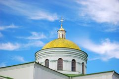 Yellow dome of the Church. Against the blue sky stock images