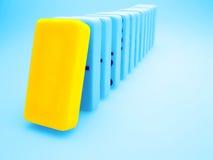 Yellow domino Stock Images