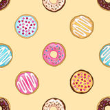 Yellow donuts pattern Royalty Free Stock Photos