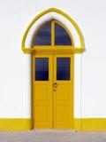 Yellow door. Taken in Nazaré, Portugal. Old building, well preserved Stock Photo