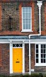 Yellow door Stock Images