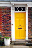 Yellow door. In a red brick house