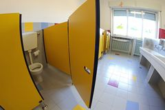 Yellow door into bathrooms with sinks of a nursery Royalty Free Stock Photography