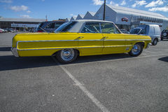 Yellow 4 door chevrolet Stock Photos