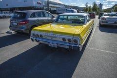 Yellow 4 door chevrolet Stock Photo