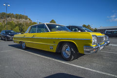 Yellow 4 door chevrolet Stock Image