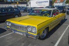 Yellow 4 door chevrolet Royalty Free Stock Photography
