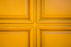 Yellow door closeup. Cross middle of yellow doors Stock Image