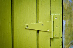 Yellow door hinge Stock Photo