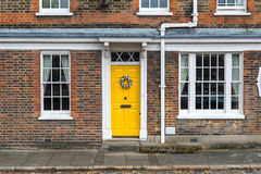 Yellow door home royalty free stock photos