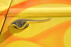 Yellow door lever Stock Photo