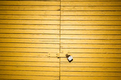 Yellow door with lock Stock Photo